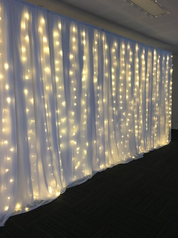 white curtain with fairy lights